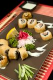 Sushi with souce and chopsticks Royalty Free Stock Images