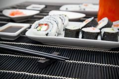Sushi and soy sauce on bamboo mat Stock Image