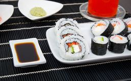 Sushi and soy sauce on bamboo mat Royalty Free Stock Photo