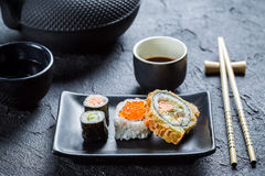 Sushi with soy sauce on the black ceramic dish Royalty Free Stock Photos