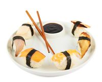 Sushi with soy sauce on a plate Stock Images
