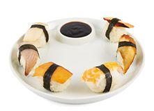 Sushi with soy sauce on a plate Royalty Free Stock Images