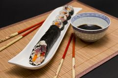 Sushi and soy sauce served with chopsticks Stock Images