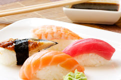 Sushi and soy sauce on white plate Royalty Free Stock Photo