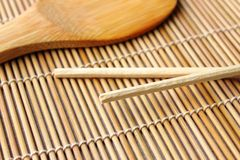 Sushi spoon. Sushi carpet and spoon of wood Stock Photos