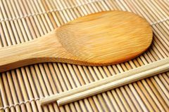 Sushi spoon and sticks Royalty Free Stock Image