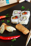 Sushi and spring rolls. Sushi on plate with spring rolls stock images