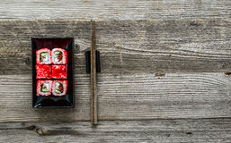 Sushi on square black plate Stock Photos