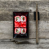 Sushi on square black plate Stock Photo