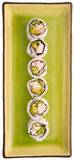 Sushi su una zolla verde isolata su bianco Fotografia Stock Libera da Diritti