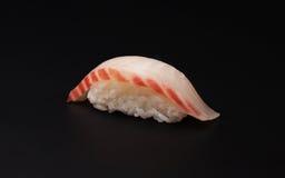 Sushi, subida, pescado, fondo negro Fotografía de archivo