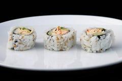 Sushi sulla zolla bianca 1 Immagine Stock