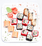 Sushi sulla zolla bianca Fotografie Stock