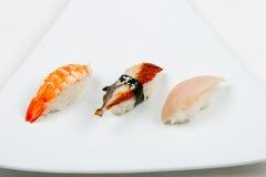 Sushi sur le blanc Photo stock