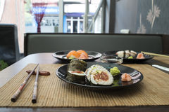 Sushi in sushi bar Royalty Free Stock Photo