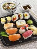 12 pieces Sushi on a black plate. stock photos
