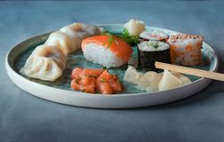 Sushi and sushi roll set on a blue plate royalty free stock photography