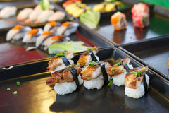 Sushi and sushi rolls. Served on black  tray at the market, various Royalty Free Stock Photo