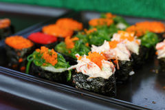 Sushi and sushi rolls. Served on black  tray at the market, various Stock Photography