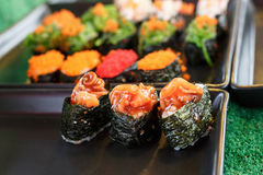 Sushi and sushi rolls. Served on black  tray at the market, various Stock Image