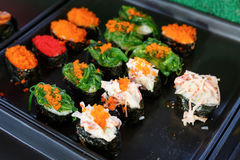 Sushi and sushi rolls. Served on black  tray at the market, various Stock Photos