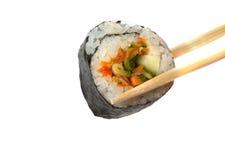 Sushi susi. Sushi with chopsticks shot on white stock image
