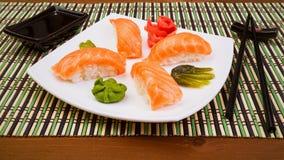Sushi syake on white square plate Royalty Free Stock Photo