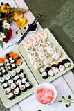 Sushi table. Abundant selection of fine homemade sushi on the table Royalty Free Stock Photography