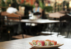 Sushi on the table. Focus is on the second row and falls off in the front and back Royalty Free Stock Image