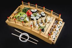 Sushi table with california, avocado, hosomaki and tempura rolls on a wooden table stock photos