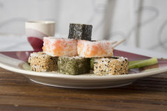 Sushi on the table. Sushi in the form of a pyramid on a plate Royalty Free Stock Photos