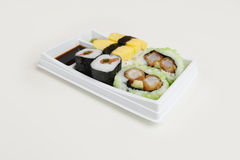 Sushi takeaway. Sushi mix in a takeaway pack isolated on white Royalty Free Stock Photos