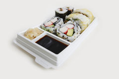 Sushi takeaway. Sushi mix in a takeaway pack isolated on white Stock Photo