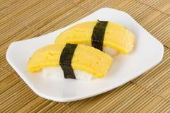 Sushi - Tamago Nigiri Stock Images