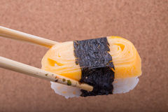 Sushi, Tamagoyaki, shrimp eggs, Tamagoyaki, Ebiko, Ebi Nigiri. This is surrounded by Maki Sushi and pages. Focus Tamagoyaki. Blurred background, there are some Royalty Free Stock Photography