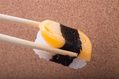 Sushi, Tamagoyaki, shrimp eggs, Tamagoyaki, Ebiko, Ebi Nigiri. This is surrounded by Maki Sushi and pages. Focus Tamagoyaki. Blurred background, there are Royalty Free Stock Photo