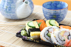 Sushi and Tea. On a bamboo mat royalty free stock photo