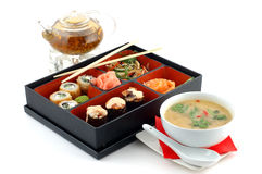 Sushi with tea and soup. On a white background stock photos