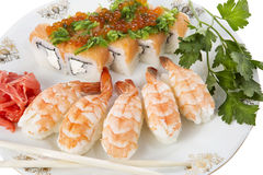 Sushi and tiger shrimps. On a white background Stock Photography