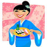 Sushi time. Japanese woman in kimono serving sushi and sake Stock Photos