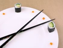 Sushi Time Concept with caviar on white plate Stock Photo