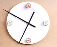 Sushi time in the form of a wall clock Royalty Free Stock Image