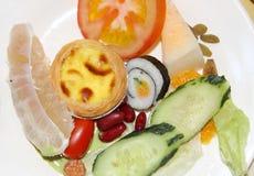 Sushi ,tomato,cake and fruit Royalty Free Stock Photography