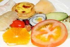 Sushi ,tomato,cake and fruit Stock Image