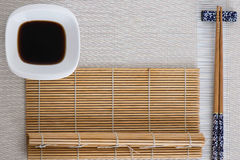 Sushi tools on white with bamboo mat Royalty Free Stock Image
