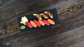Sushi top view. Japanese food on wooden background stock video footage