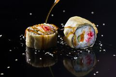 Sushi with toppings. Japanese sushi with toppings on an isolated background Royalty Free Stock Images