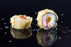 Sushi with toppings. Japanese sushi with toppings on an isolated background Stock Photography