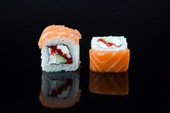 Sushi with toppings. Japanese sushi with toppings on an isolated background Royalty Free Stock Photos