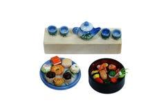 Sushi, torte del tè e tè Immagine Stock